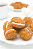 Pumpkin cookies with cream filling, close-up