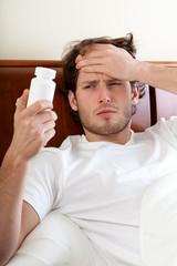 Unwell man with headache