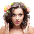 beautiful young woman with flower in hair