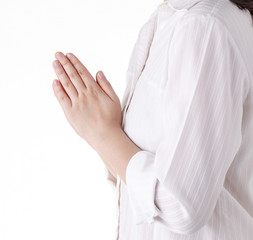 Woman praying isolated on white background