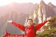 cheering woman hiker open arms at peak of mountain huashan