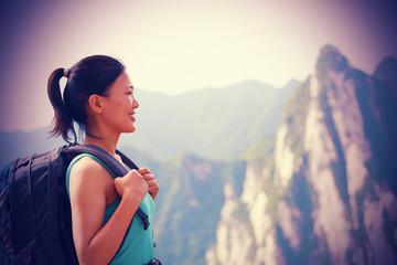 woman hiker at peak of mountain huashan