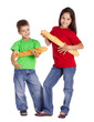 Two kids with french baguettes