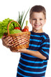 Smiling boy with basket of vegetables