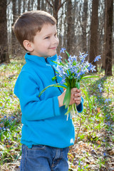 Boy with bouquet of bluebells
