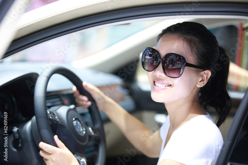 happy woman driver driving a car