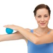 Portrait of a content young woman holding stress ball on arm