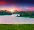 Beautiful summer landscape on the lake. Sunrise