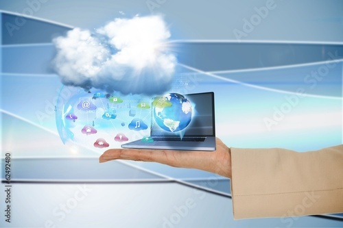 Hand presenting cloud and app icons with laptop