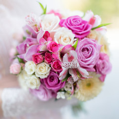 Bridal bouquet. Beautiful bouquet in hand of bride