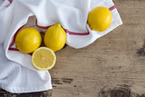 Lemon on rustic wooden background