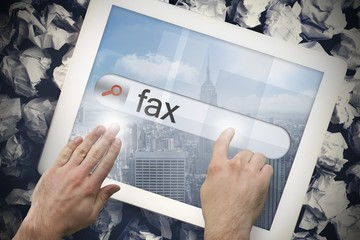 Hand touching fax on search bar on tablet screen