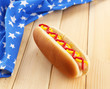 Tasty hot dog on wooden table