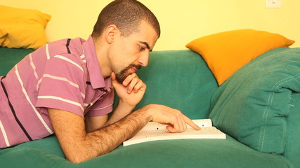 Man Studying on Sofa