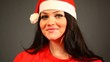 Cheerful Woman with Santa Hat