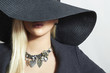 Beautiful Blond Woman in Black Hat.Lady in Jewelry