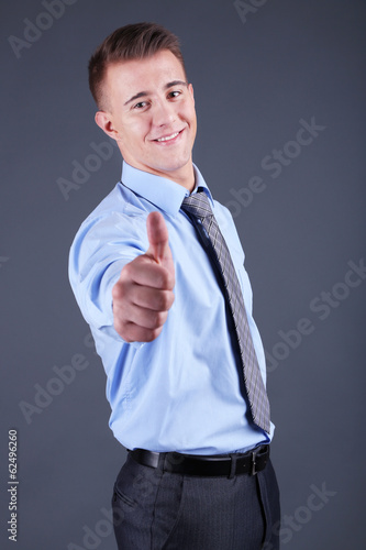 Handsome young man on gray background