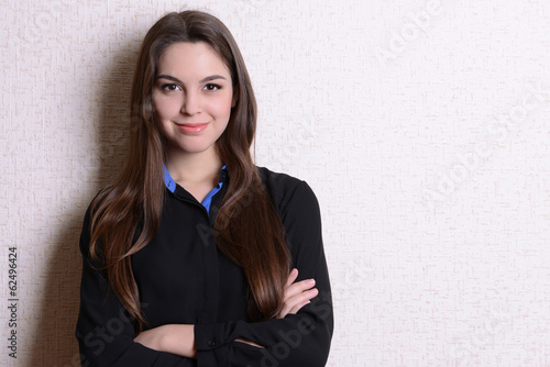 Portrait of businesswoman near wall