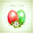 Two decorative Easter eggs on green background