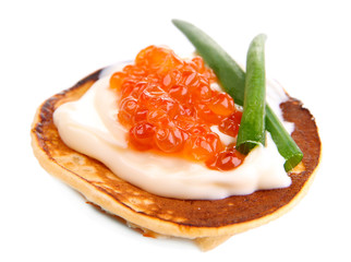 Pancake with red caviar isolated on white