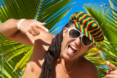 Portrait of happy young man with dreadlocks