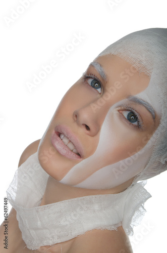 Portrait of young woman with face art and bandage
