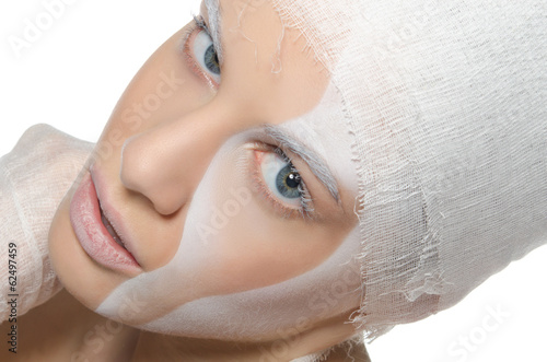 Young woman with face art and bandage