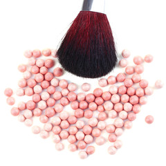 Powder balls and brush isolated on white