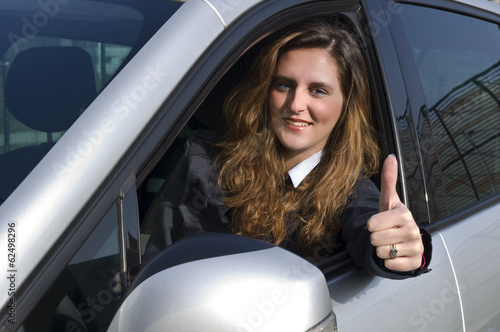 Man in a car with thumbs up