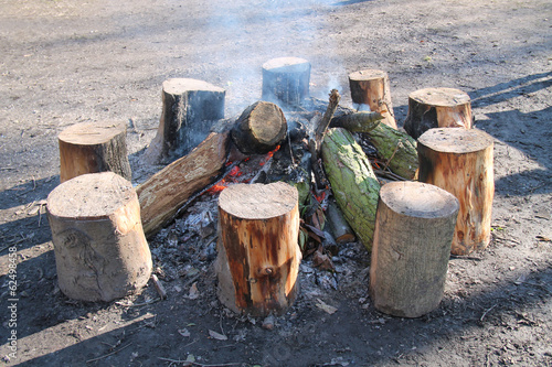 A Large Outdoor Wooden Log Warming Bonfire.