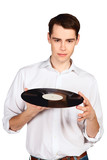 Young man with vinyl disk isolated on white background