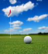 Golf ball in front of flag - 62498880