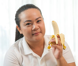 Fat woman with banana