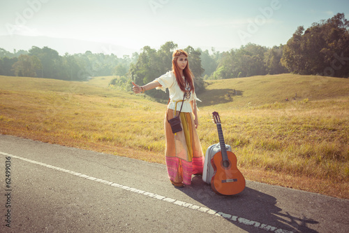 Hippie girl hitchhiking