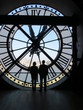 Two people silhouetted by huge clock