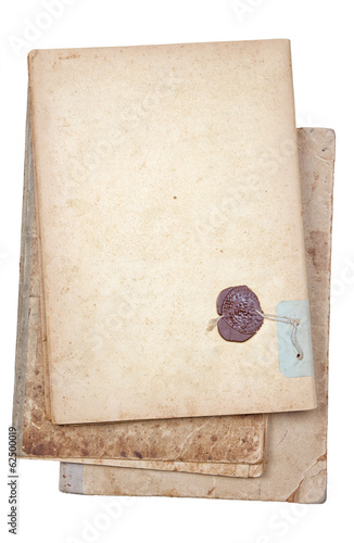 Old writing-book with the sealing wax press on a white backgroun