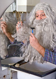 man adjusts his beard