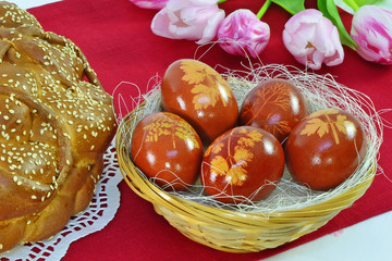 Easter eggs, bread, tulips