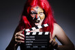 Woman with facepaint and movie clapper