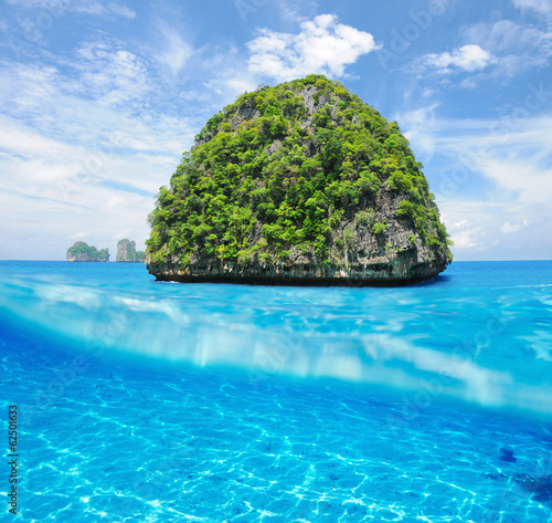 Uninhabited island with white sand bottom underwater view