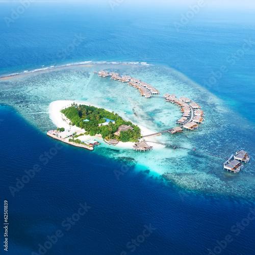 Leinwandbild Motiv Atolls and islands in Maldives from aerial view