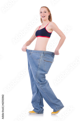 Woman with large jeans in dieting concept