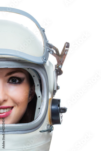 Young woman with makeup wearing space helmet isolated on white