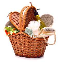 Natural bath sponges, pumice, gel and flowers in the basket