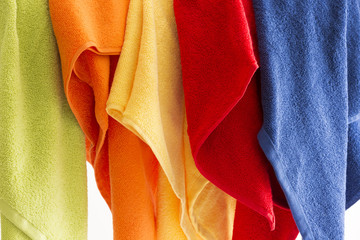 Colorful towels hanging in a row