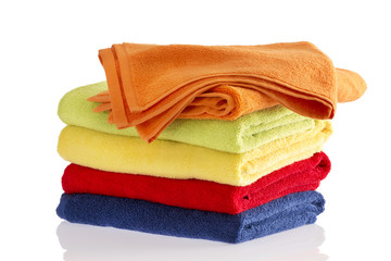 Stack of soft towels in the colors of the rainbow