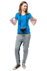Happy animated young woman with a camera