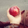 holding juisy apple
