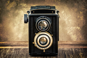 Old fashioned antique camera in vintage style
