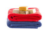 Neatly folded cotton towels with soap